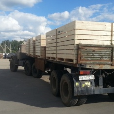 trailer full of wooden boxes